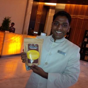 Hotel concierge holding a bag of coffee
