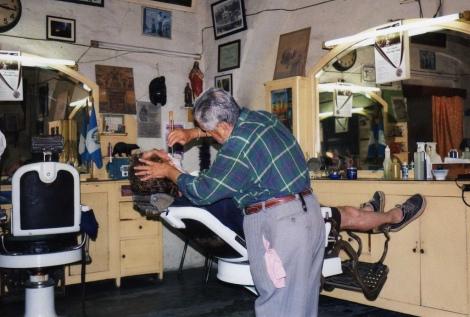 Antiguan barber shaving a customer