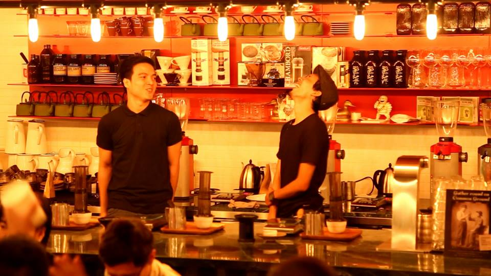 Male baristas having fun