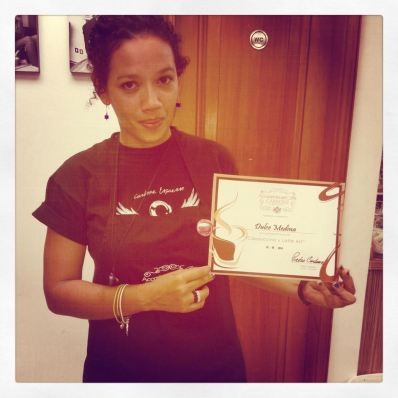 Barista holding certificate